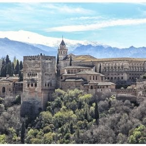 Artistic colour photo print of the Alhambra in Granada, Spain against snow capped mountains.