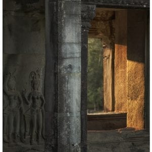 Artistic photo print of sunlight streaming through the ancient ruins of Angkor Wat temple in Siem Riep, Cambodia.