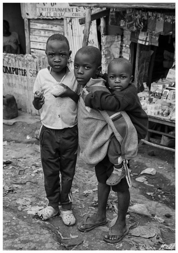 Artistic B&W photo print of three children living in Kibera Slum in Nairobi, Africa's largest slum.