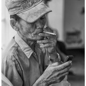 Artistic B&W photo print of a man smoking a cigarette on a ferry in Yangon, Myanmar (Burma).