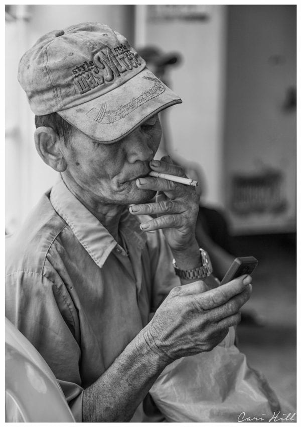 Artistic B&W photo print of a man smoking a cigarette on a ferry in Yangon, Myanmar (Burma).