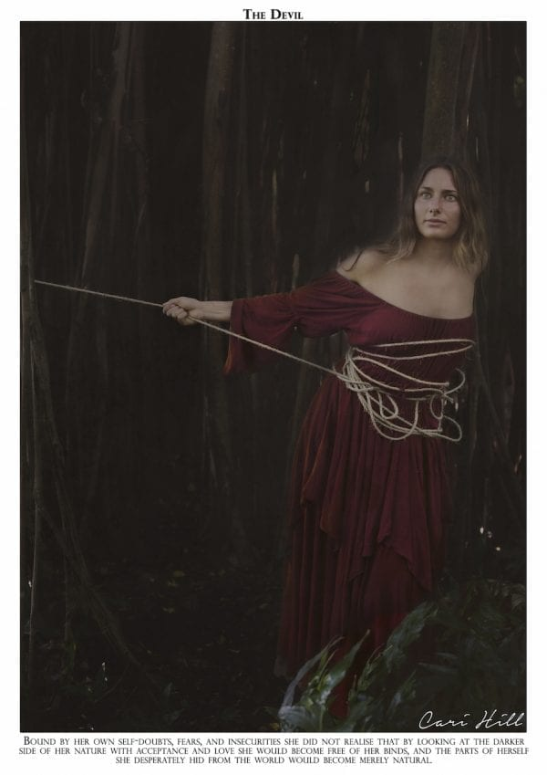 Artistic colour photo print of a tarot recreation depicting the card of The Devil with original text.