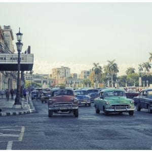 Artistic colour photo print of a street scene in Havana, Cuba with classic cars.