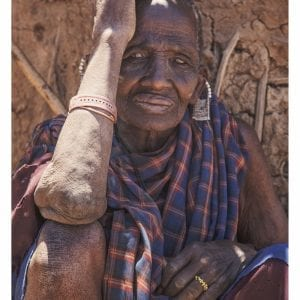 Artistic colour photo print of a Maasai elder in a village in Serengeti, Tanzania.