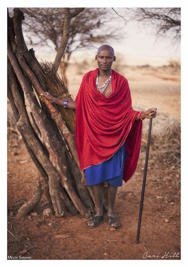 Artistic colour photo print of a portrait of a Massai warrior in Amboseli, Kenya near Mount Kilimanjaro.