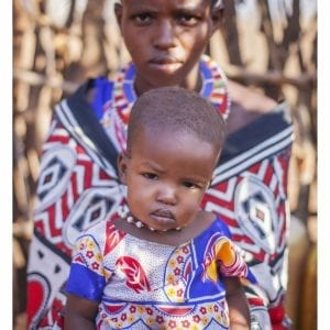 Artistic colour photo print of a portrait of a Massai woman and her child both in traditional dress in Amboseli, Kenya near Mount Kilimanjaro.