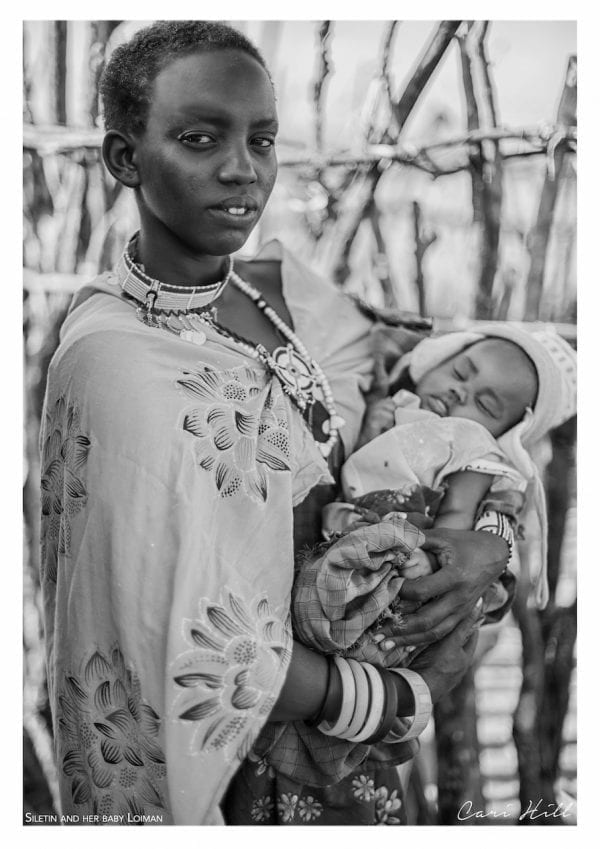 Artistic B&W photo print of a portrait of a Massai mother and child in traditional dress in Amboseli, Kenya near Mount Kilimanjaro.