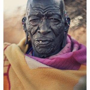 Artistic colour photo print of a portrait of a 100 year old Maasai man in Amboseli, Kenya near Mount Kilimanjaro.
