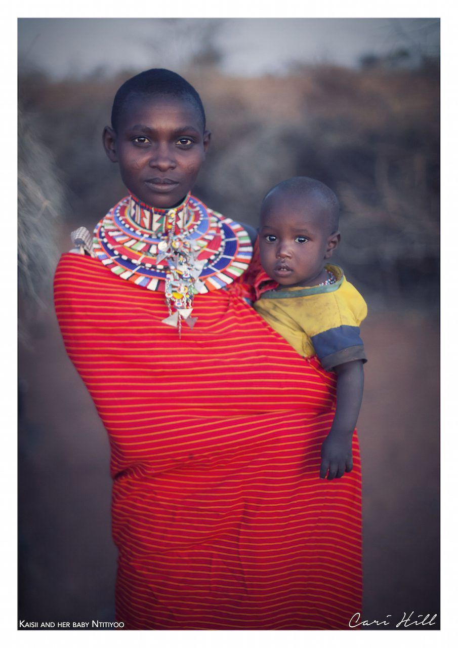 Artistic colour photo print of a portrait of a Massai mother in traditional dress and her child in Amboseli, Kenya near Mount Kilimanjaro.