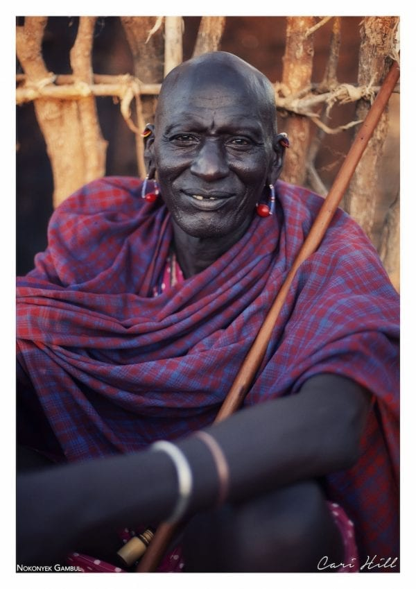Artistic colour photo print of a portrait of a Massai man in a purple cloak in Amboseli, Kenya near Mount Kilimanjaro.