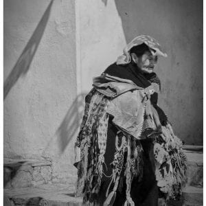 Artistic B&W photo print of a lady carrying many scarves for sale in San Cristobal, Mexico.
