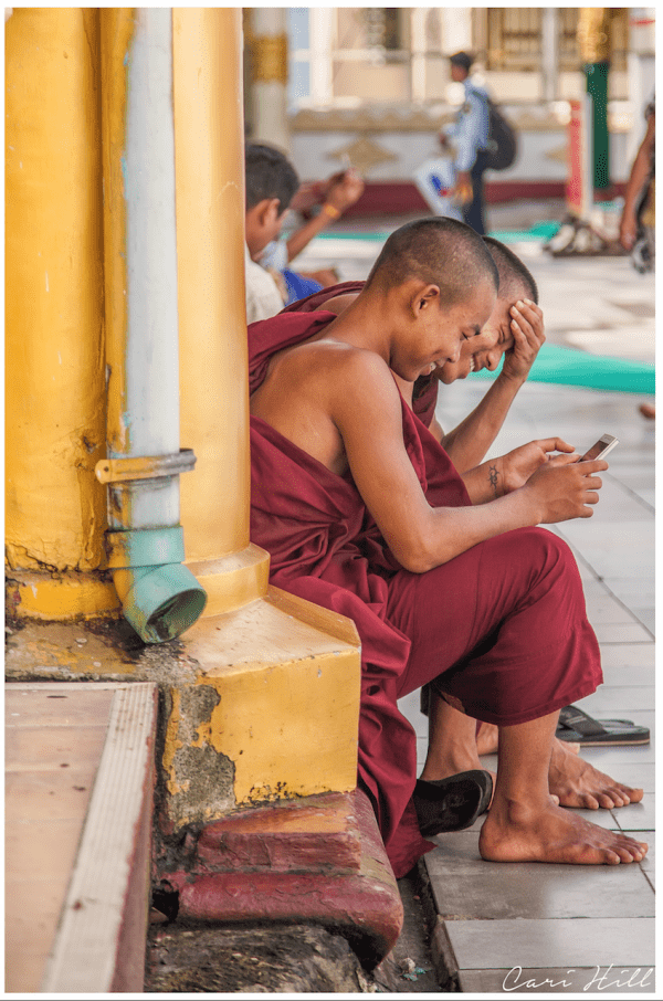 Artistic colour photo print of two monks with a cellphone at Shwedagon Pagoda, Myanmar, Burma.