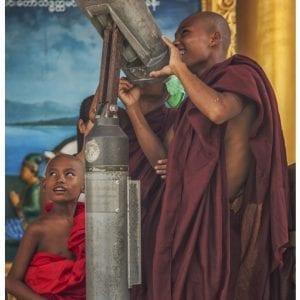 Artistic colour photo print of monks looking through a telescope at Shwedagon Pagoda, in Yangon, Myanmar (Burma).