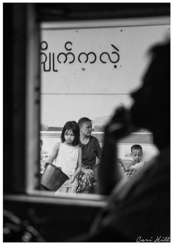 Artistic B&W photo print of a family outside a train window framed by a silhouette in Yangon, Myanmar (Burma).