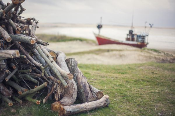 Artistic colour photo print of an old fishing boat moored at shore in Cabo Polonio, Uruguay.