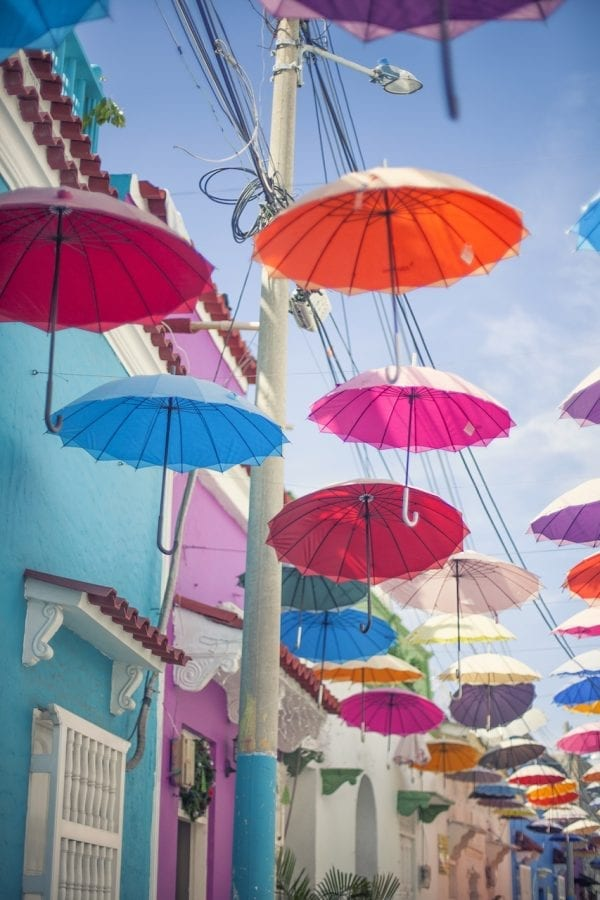 Artistic colour photo print of an alley of colourful umbrellas in Cartagena, Colombia.
